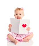 Het mooie babymeisje met leuke valentijnskaartprentbriefkaar met een rood hoort Royalty-vrije Stock Fotografie