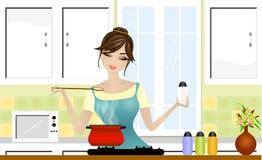Het mooie dame koken Stock Fotografie