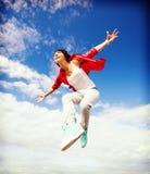 Het mooie het dansen meisje springen Royalty-vrije Stock Afbeeldingen
