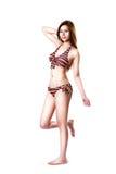 Het mooie jonge Aziatische de vrouw van de zwempakmanier stellen Stock Foto