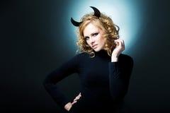Het mooie jonge meisje een duivel Stock Foto