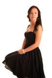 Het mooie jonge volwassen meisje zit in zwarte kleding Royalty-vrije Stock Afbeelding