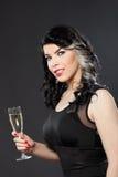 Het mooie jonge vrouw vieren met een glas champagne Royalty-vrije Stock Fotografie