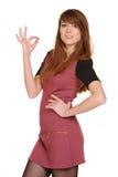 Het mooie jonge vrouwelijke tonen duimen omhoog Royalty-vrije Stock Afbeeldingen