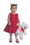 Het mooie kind met wit draagt. Stock Foto