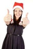 Het mooie meisje dat van de Kerstman hand o.k. teken toont Stock Afbeeldingen