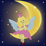 Het mooie meisje de feezitting op de maan Stock Afbeeldingen