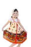 Het mooie meisje in een kleding danst. Stock Afbeelding