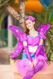 Het mooie meisje in een kostuum van de fee Stock Foto