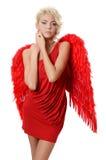 Het mooie meisje in een kostuum van een rode engel Royalty-vrije Stock Foto's