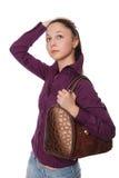 Het mooie meisje met een zak op schouders, Stock Afbeeldingen