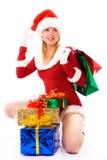 Het mooie meisje met Kerstmis stelt voor Stock Afbeelding