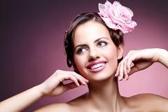 Het mooie meisje met nam in haar toe Royalty-vrije Stock Foto