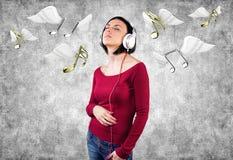 Meisje met oortelefoons Stock Fotografie