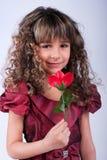 Het mooie meisje met rood nam toe Royalty-vrije Stock Afbeeldingen