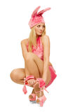 Het mooie meisje in roze kostuum. Stock Afbeeldingen