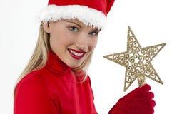 Het mooie meisje van de Kerstman op wit dat Kerstmis houdt Stock Foto's