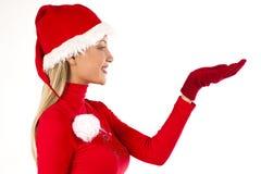 Het mooie meisje van de Kerstman op wit het voorstellen/holding s Stock Foto's