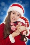 Het mooie Meisje van Kerstmis met teddybeer Stock Afbeelding