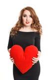Het mooie meisje in zwarte kleding met rood hoort op een witte achtergrond royalty-vrije stock foto