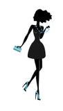 Het mooie silhouet van het maniermeisje. Stock Fotografie