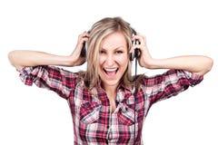 Het mooie volwassen sensualiteit blonde meisje is luistert t Stock Afbeelding