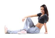 Het mooie vrouw ontspannen na het doen van oefening stock foto's