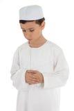 Het moslim jongen bidden Stock Fotografie