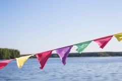 Het Multi-colored vlaggen fladderen Stock Foto