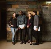 Het multiraciale creatieve team stellen voor camera in bureau stock afbeelding