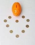 Het muntstuk van het spaarvarken en van tien Roepie van India Royalty-vrije Stock Afbeeldingen