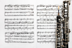 Het muzikale blad van de instrumentenmuziek neemt nota van hobo Stock Foto's
