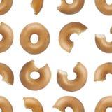 Het naadloze patroon van beten ging een doughnut van start Stock Foto's