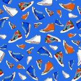 Het naadloze patroon van tennisschoenenschoenen vector illustratie