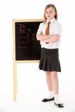 Het nadenkende Vrouwelijke Dragen van de Student Eenvormig naast Royalty-vrije Stock Foto's