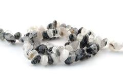 Het natuurlijke minerale haar van het steenkwarts met de zwarte halfedelsteen van tourmalinekristallen Stock Afbeelding