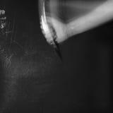 Het neersteken in dark Stock Afbeelding