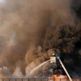 Het neerzetten van de brand Stock Afbeeldingen