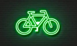 Het neonteken van het fietspictogram op bakstenen muurachtergrond Stock Afbeeldingen