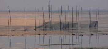 Het net van de visserij in meer stock fotografie