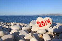 het nieuwe jaar van 2014 op het strand Stock Afbeelding