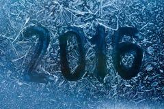 Het nieuwe malplaatje van de jaaruitnodiging geschreven op bevroren Stock Foto's