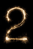 Het nieuwe sterretje nummer twee van de jaardoopvont op zwarte achtergrond Royalty-vrije Stock Foto