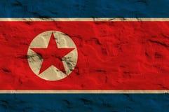 Het noorden Koreaanse vlag op het zand Stock Foto