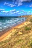 Het noordenkust van Cornwall bij Sluisdeurbaai Engeland UKbetween Newquay en Padstow in kleurrijk HDR Royalty-vrije Stock Fotografie