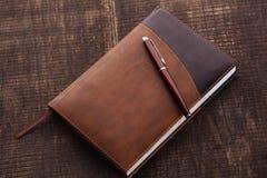 Het notitieboekje en de pen Stock Fotografie