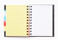 Het notitieboekje van het ringsbindmiddel met gele referentie Royalty-vrije Stock Fotografie