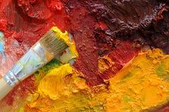 Het olieverfschilderijpalet van kunstenaars Stock Foto