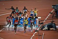 Het olympische atleten lopen royalty-vrije stock afbeelding