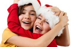 Het omhelzen van de jonge geitjes van de Kerstman Stock Afbeelding